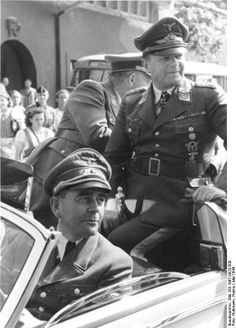 Albert Speer (driving) and Luftwaffe Field Marshal Milch visit an aircraft factory, May 1944. Milch was in charge of air force procurement, with specific portfolio aircraft development and procurement. Speer's overhaul of production methods kept boosting aircraft production until the end of the war, to no avail though.