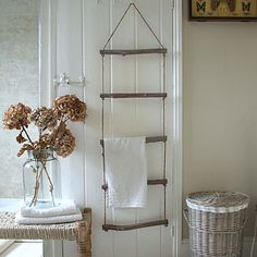 Rope And Driftwood Towel Ladder, via not on the high street. This looks like an…