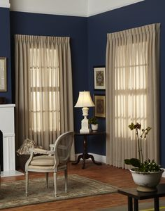 Inverted pleat sheer curtains add the right amount of texture in this traditional sitting area.