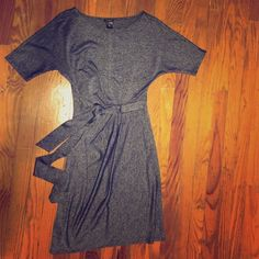 Ann Taylor Navy and silver work dress Ann Taylor work dress. Super comfy and reminiscent of MadMen. Belt is attached and pleats at waist flatter your figure. Worn twice. Excellent condition. No trades. No PayPal. Ann Taylor Dresses