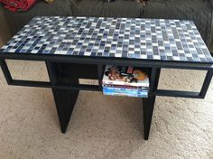 Ikea hack coffee table - cd/DVD racks with glass tile and plywood.