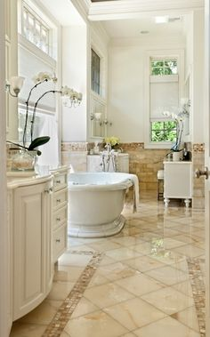 25 Amazing Bathroom Designs  I love the floor!!  And the windows.                                                                                                                                                                              More