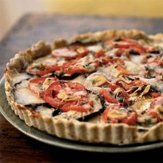 Eggplant, Tomato, and Smoked Mozzarella Tart Recipe Side Dishes with all-purpose flour, toasted wheat germ, baking powder, ground black pepper, salt, water, olive oil, cooking spray, eggplant, salt, olive oil, garlic cloves, fresh basil, fresh oregano, chopped fresh mint, plum tomatoes, mozzarella cheese, fresh parmesan cheese