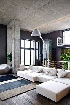 Raw cement look giving this living area an industrial feel. www.habitat-my.com