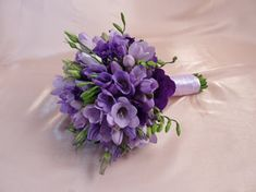 I love this idea for the bouquet. It's so simple, yet it still incorporates all the shades of purple we want.