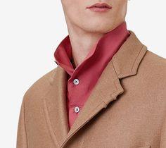 Hermès Liverpool camel wool coat with lambskin details.