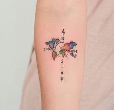 Tiny tattoo of the world map. NSEW