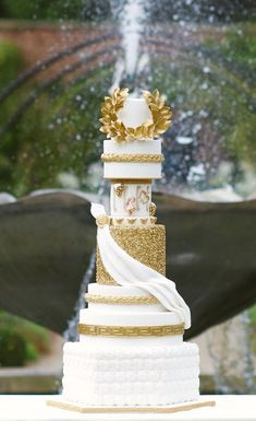 Love Wedding Cakes Grecian wedding cake by Cake Couture NI photography by Des Rowan White And Gold Wedding Cake, Elegant Wedding Cakes, Beautiful Wedding Cakes, Beautiful Cakes, Grecian Wedding, Dream Wedding, Greek Wedding Theme, Greek Cake, Royal Cakes