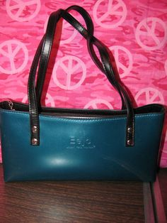 This hot little number by Beijo will satisfy your every style craving    BEIJO       WOMENS BLUE    SATCHEL/SHOULDER HANDBAG    EXCELLENT CONDITION    FOR PREOWNED    FEW MINOR SURFACE SCRATCHES    SILVER EMBELLISHEMENT HARDWARE    ZIPPERED CLOSURE    ZIPPERED & SLIDE POCKET INSIDE    FULLY LINED    5 IN HEIGHT    10 IN LENGTH    4 3/4 IN DEEP    9 IN STRAP DROP    AWESOME HANDBAG    GOTTA LOVE THE COLOR    WONDERFUL ADDITION    TO YOUR WARDROBE