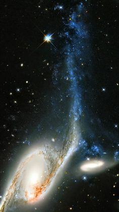 galaxy NGC 6872 in the constellation of Pavo (The Peacock). Its unusual shape is caused by its interactions with the smaller galaxy that can be seen just above NGC 6872, called IC 4970. They both lie roughly 300 million light-years away from Earth.