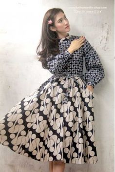 Batik Amarillis made in Indonesia Batik Amarillis's Ildiko dress .this inspired dress oozing romanticism with this full circle skirt,beautiful puff sleeves , unique belt and each details lends the style an ethereal charm. Batik Fashion, Hijab Fashion, Fashion Dresses, Fashion Belts, Blouse Batik, Batik Dress, Kimono, Batik Blazer, Batik Muslim