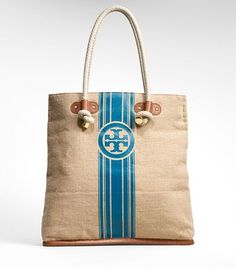Tory Burch bag to compliment my Lisa Blue orchid flower scrunch dress