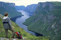 A tourist looks out over Western Brook Pond situated in Gros Morne National Park in Newfoundland, Canada.