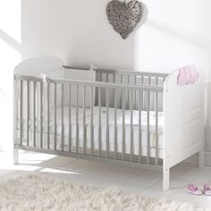 Harriet Bee A traditional and timeless Emeline Cot with panelled ends and a gently curving top rail. Practical and stylish, the Emeline Cot from Harriet Bee is made from solid pine and would look fantastic in a modern styled nursery. Baby Cot Mattress, Cot Bedding, Sleigh Cot Bed, Travel Cot, Mattress Springs, Baby Bedroom, Toddler Bed, Solid Pine, Solid Wood