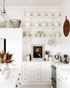 30 vintage wall decor ideas for your kitchen. Get inspired by vintage paintings, light fixtures, platters, clocks, signs, and more. Discover beautiful, modern kitchens with vintage accents. For more kitchen inspiration, visit domino.com.