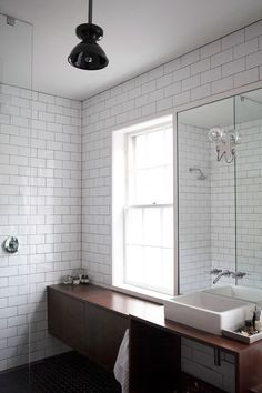 A Hint of Bohemian Austin in Historic Virginia | @DesignSponge #bathroom #tile #white #minimal #decor #design