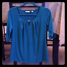 New York & Co blouse Beautiful half sleeve, teal colored blouse. Metal accent bar across top. New, never worn. I pulled the tags off, THEN realized that it didn't fit me, and now I can't return it. NWOT New York & Company Tops Blouses