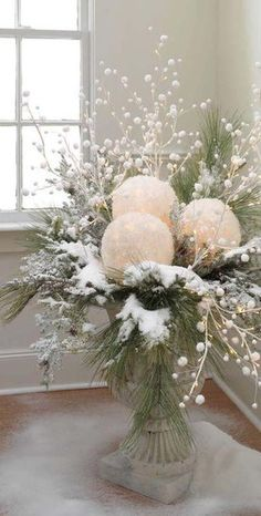 snow balls ~  take white balloons and white tissue paper. blow up balloons, dip tissue in glue, cover balloons and let dry. cut out a space for battery tea light and use in center pieces