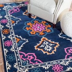 Nova Rug in Navy - A stylish foundation for your dining room or den, this hand-looped wool rug showcases a multicolor floral motif.