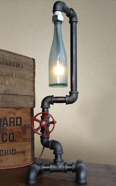 Got to have!!! Cool desk lamp with industrial eclectic look,  vintage pipe base, antique sea glass bottle as shade over bulb lamp, lighting ideas for the house
