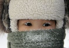 Viktor Everstov, A child, with eyelashes covered with frost, is seen along a street in the eastern Siberian city of Yakutsk in Sakha (Yakutia) Republic, Russia, on February 10, 2012. The air temperature in Yakutsk is about -35 degrees Celsius.