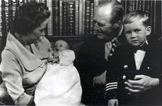 Princess Ragnhild and her father, King Olav V, admiring her 2nd child, daughter Ingeborg Lorentzen, while her eldest, son Haakon, looks to the camera for attention.
