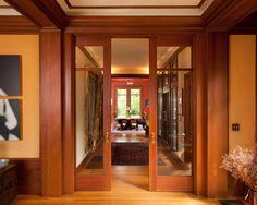 The Alluring Wooden Pocket Doors: Attractive Craftsman Hall With Elegant Wooden Pocket Doors With Glass Windows Laminate Floor Peach Wall Colors Elegant Dining Set ~ bukitbear.com Interior Design Inspiration
