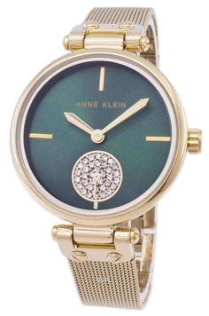 Features:  Gold Tone Stainless Steel Case Gold Tone Stainless Steel Mesh Bracelet Quartz Movement Mineral Crystal Green Dial Analog Display Small Second Sub Dial Swarovski Crystal Pull/Push Crown Solid Case Back Jewelry Clasp 30M Water Resistance  Approximate Case Diameter: 34mm Approximate Case Thickness: 9mm