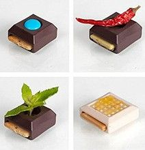 This is a project by French designer Elsa Lambinet called Sweet Play. It's basically a modular design in chocolate deliciousness which allows you to build your perfect bite of chocolate depending on your mood.