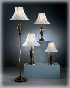 This antique brass finished metal lamp group features 1 accent lamp, 2 table lamps and 1 floor lamp with creamy fabric bell shades. Table and floor lamps feature switches and the accent lamp features an on/off switch. Copper Lamps, Brass Table Lamps, Copper Metal, Table Lamps For Bedroom, Table Lamp Sets, Traditional Table Lamps, Lamps For Sale, Furniture Factory, Signature Design