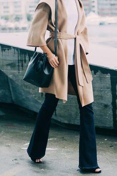 belted camel coat, white top, Mansur Gavriel bucket bag and wide leg jeans #style #fashion #fall #denim