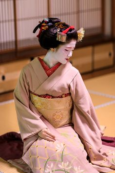 (Maiko, Katsuna. Kyoto. Japan.) She finished the Maiko in May 2017. (Maiko is only from 15 to 20 years old) This picture is from the last photo session she is wearing a kimono of Maiko.