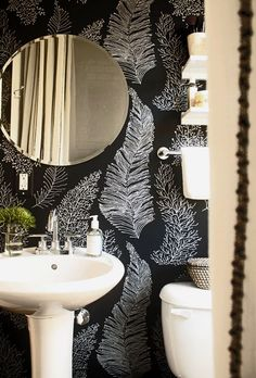 dramatic organic wallpaper in a small bathroom