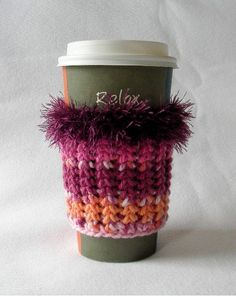 Crochet Coffee Cup Cozy Sleeve Plum Raspberry Pink and Orange with Eyelash yarn Trim. $7.00, via Etsy.