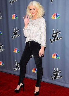 Christina Aguilera waved for the camera at the Voice's season five top 12 event.