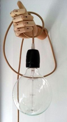 20 DIY Lamp or Lighting Ideas: these are so fun & cool! Any if these lights are sure to impress and bring a smile to any guests face. Wooden floor lamps, glitter shades, multi mason jar chandelier , colander drop light or chandelier, multi grater chandelier, concrete lights, wooden hand light sconce, skateboard wall light, flat wood wall light, stick figure drop light. All of them are just really cool! @istandarddesign