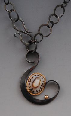 Barbara Umbel ~ forged and fabricated sterling silver and 14kt gold with limpet shell.
