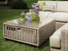 Living Room: Outdoor Coffee Table With Storage. coffee table with storage. rattan coffee table. rattan sofa. glass top coffee table. outdoor living space.