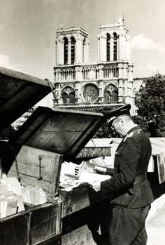 War and Conflict, World War II, The Fall of France, pic: 1940, A German officer at a street bookstall in front of Notre Dame Cathedral, Paris (Photo by Popperfoto/Getty Images)