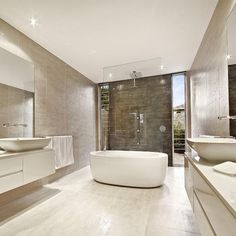 Up In The Bathroom A Modern Freestanding Bath Tub Takes Center Interesting Acs Designer Bathrooms Design Ideas