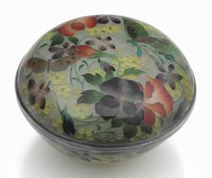 Japanese Art:  Meiji Period Magnificence  | Description  A plique-à-jour enamel box and cover  Meiji period (late 19th century)  The circular box with fitted cover decorated in translucent enamels and silver wires with various flowers and butterflies 3in. (7.6cm.) diameter | Christie's