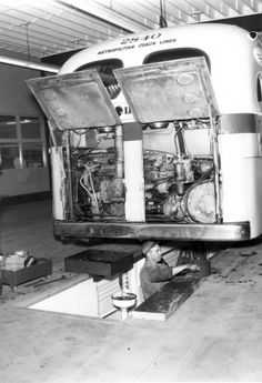 Metropolitan Coach Lines bus rests over a mechanic's pit with engine doors open, circa Rv Travel Trailers, Bus Travel, Old Photos, Vintage Photos, Camper, Bus Terminal, Bus Coach, Bus Station, Busses