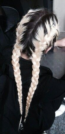 ultra long pleated pigtails on peroxide blonde hair with sharp contrast dark roots