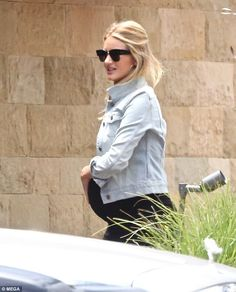 Not long now! Rosie Huntington-Whiteley, 30, showcased her burgeoning baby bump as she ste...