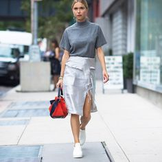 - A sheeny, metallic wrap slit skirt looks effortless with a mock neck knit and white sneakers.