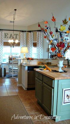 I love this...love the curtain idea...love this!!!  Perfect idea for the kitchen!!!