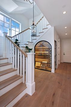 How stunning is this design? We can't take our eyes off of the wine cellar built into the staircase! | Brandon Architects