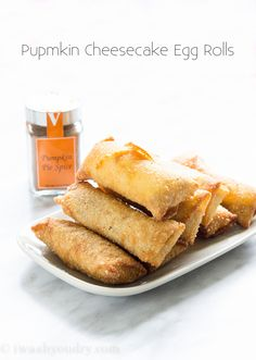 Pumpkin Cheesecake Egg Rolls - wait til you taste these babies! Our family requests these every year during the holidays. Pumpkin Cheesecake Egg Rolls are a combination between pumpkin pie and cheesecake all wrapped and fried! Just Desserts, Delicious Desserts, Dessert Recipes, Yummy Food, Cupcake Recipes, Snack Recipes, Pumpkin Dessert, Pumpkin Cheesecake, Pumpkin Recipes