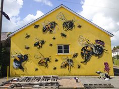 A London Street Artist Paints Swarms of Bees on Urban Walls to Raise Awareness of Colony Collapse