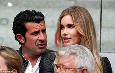 Luis Figo (left) watches the action on Sunday with wife Helen Svedin at Madrid's Caja Magica